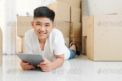 Smiling boy using app on tablet