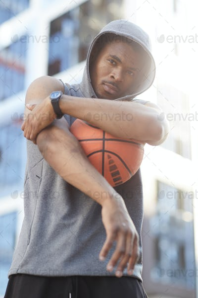 African-American Man Posing with Basketball Ball