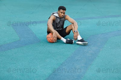 African Basketbal Player Resting