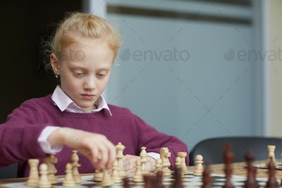 Girl practicing chess strategy