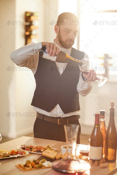 Handsome Sommelier Pouring Wine