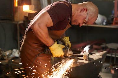 Polishing metal piece with grinder