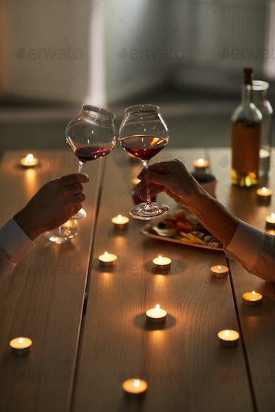 Couple Drinking Wine at Romantic Date
