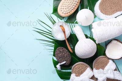 Spa, wellness, skin care, beauty and relax concept. Spa tools: white towel, bamboo slippers, herbal