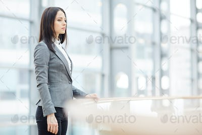 Lady manager contemplating office life