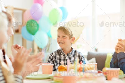 Cute Boy Smiling at Birthday Party