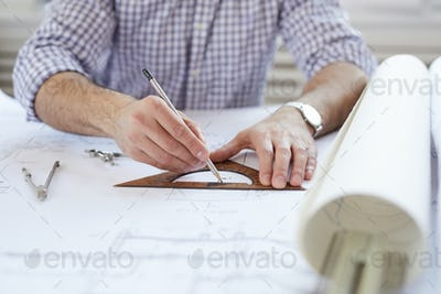 Engineer Drawing Plans at Workplace
