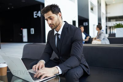 Mixed race manager examining data on laptop