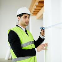 Engineer Measuring Walls