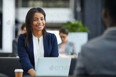 Happy black woman meeting with business partner