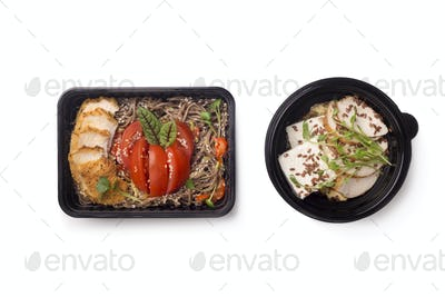 Healthy food for diet nutrition in black boxes to go on white