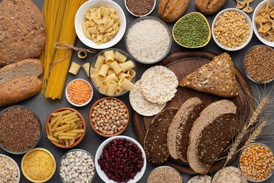 Selection of gluten free products on wooden background