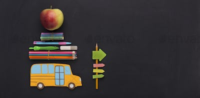 Yellow american school bus with stationery going by road signs