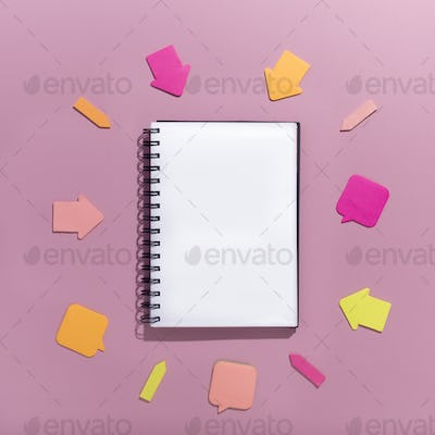 Stickers arrows showing promotion on notepad with blank space