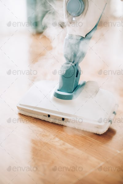 Cleaning the floor with steam cleaner. Banner and copy space. Cleaning service concept