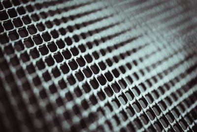 Metal background. Lattice texture with small cells grid. Selective focus point