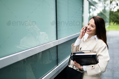Portrait of young businesswoman going to office