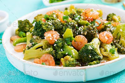 Stir fry shrimp with broccoli close up on a plate. Prawns and broccoli.