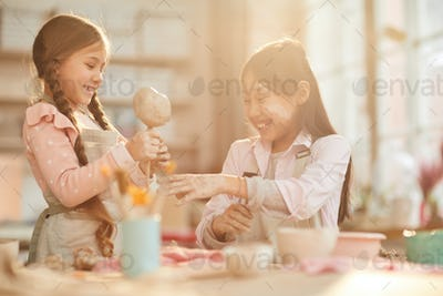 Cute Little Girls in Pottery Studio