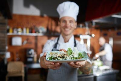 Chef Presenting Dish