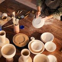 Artisans working with ceramics
