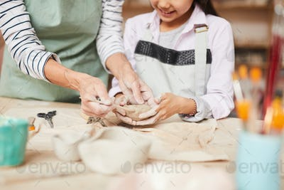 Little Girl Kneading Clay