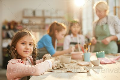 Cute Little Girl in Pottery Class