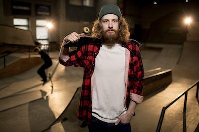 Bearded Skater Posing in Extreme Park