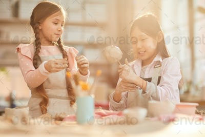 Cute Little Girls in Pottery Class