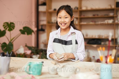 Smiling Asian Girl Enjoying Pottery Class