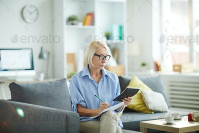 Mature Woman Calculating Budget