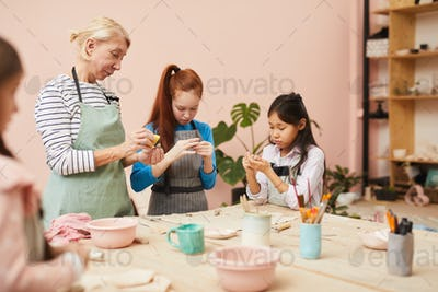 Group of Kids in Pottery Class