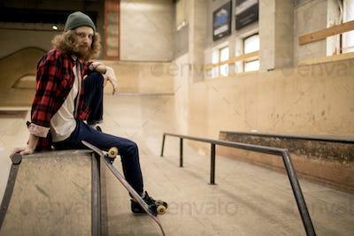 Long Haired Man in Skate Park