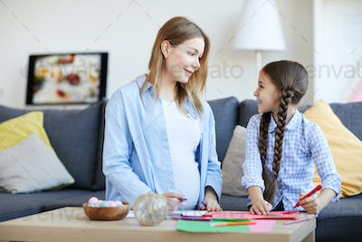 Mother and Daughter Drawing Pictures