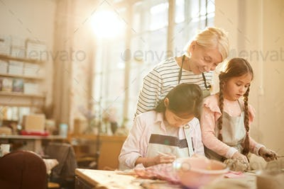 Two Little Girls in Pottery Class
