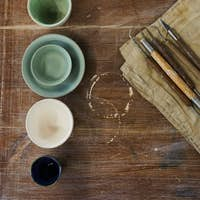Clay modelling tools and ceramic bowls