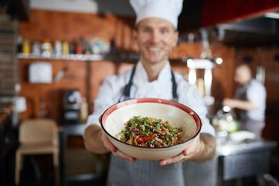 Asian Food Chef Presenting Dish