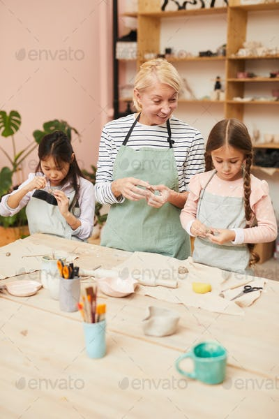 Little Girls in Pottery Workshop