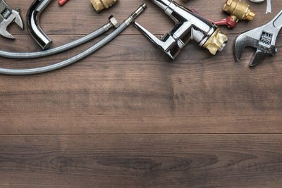 Top View Photo Of Plumbing Tools Over Wooden Background With Copy Space