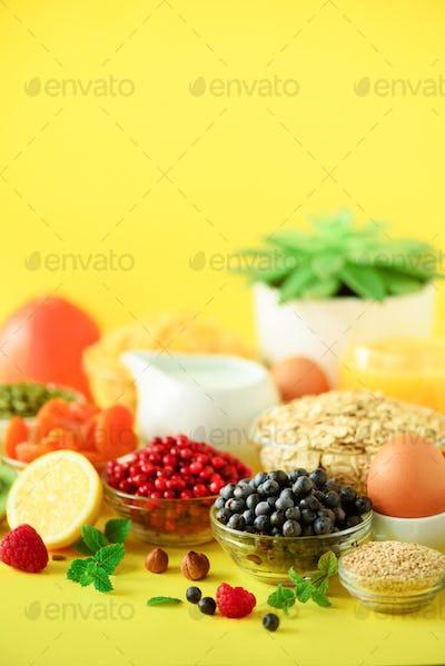 Vegan breakfast. Soft boiled egg, oat flakes, nuts, fruits, berries, milk, yogurt, orange, banana