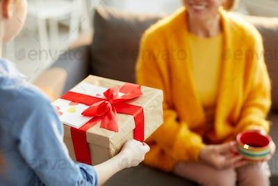 Children Presenting Gift for Mom