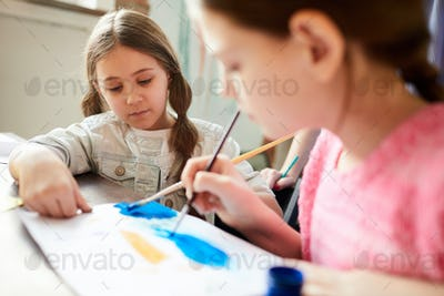 Two Sisters Painting Together