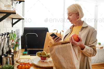 Woman checking products after shopping