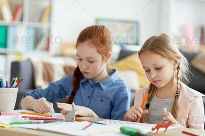 Two Girls Drawing at Home