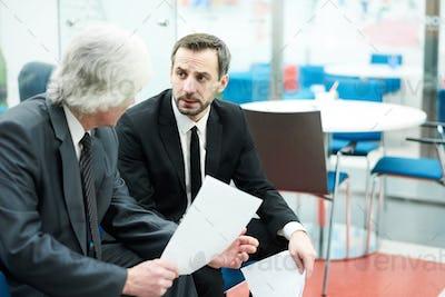 Mature Businessmen at Work