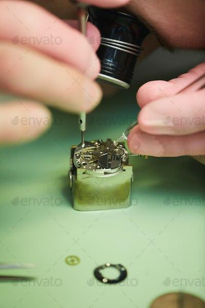 Clockmaker Repairing Watch