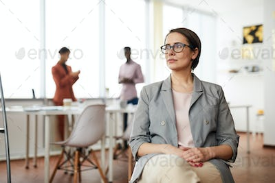 Pensive Businesswoman Sitting on Chair