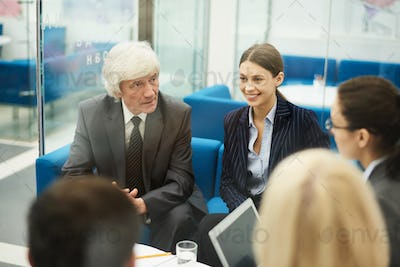 White haired Businessman in Meeting