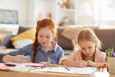 Girls Drawing in Sunlight