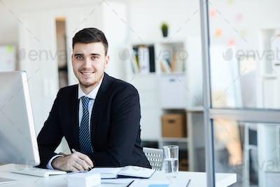 Businessman by desk